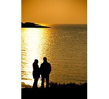 Couple silhouettes under sunset Photographic Print