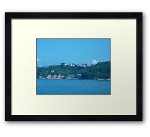 Mansions on top of island Framed Print
