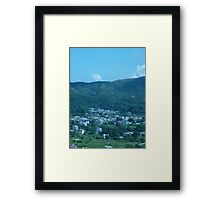 Mountains surrounding a little village Framed Print