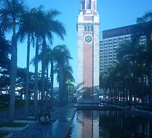 Shimmering reflection of magnificent clock tower by Joseph Green