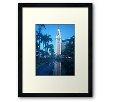 Shimmering reflection of magnificent clock tower Framed Print
