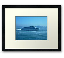 A sleek ferry powering along Framed Print