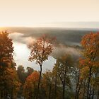 Sunrise, fog, river in autumn  by Antanas