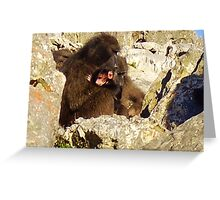 A new mother clutches her baby tight to her chest Greeting Card