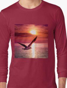 A seagull flying towards sunset Long Sleeve T-Shirt
