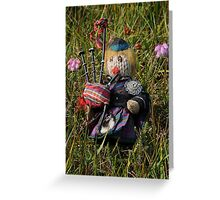 Scotty plays the Pipes beside the Cross-leaved Heath Greeting Card