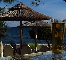 Beach Umbrellas & Mythos Beer by wiggyofipswich