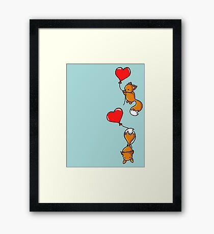 Playful Foxes Framed Print