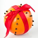 Orange with red ribbon by mariakallin