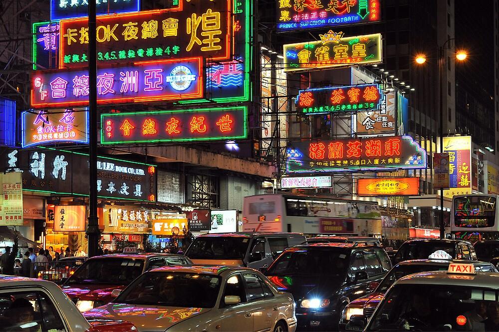 Bustling Hong Kong at night. by Ralph de Zilva