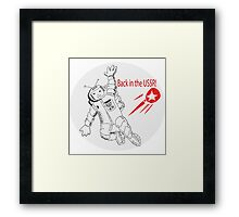 Space poster. Cosmonaut in space suit and  sputnik. Framed Print
