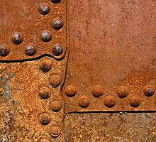 Rusty metal surface with riveted joints by Sergey Skleznev