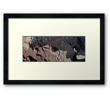 Three holes in the Rock Framed Print