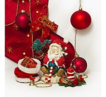 Santa Claus and Christmas candle Photographic Print