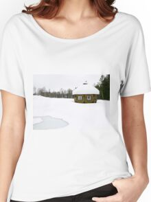 Lapland, Scandinavia, a snow covered wooden sauna shed, in a landscape of snow Women's Relaxed Fit T-Shirt