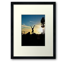 Acrobats Under a Setting Sun Framed Print