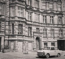 Trabant in front of Apartment Building: Berlin by Ron Greer