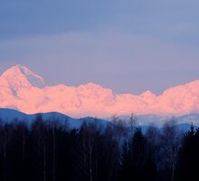 The distant Julian Alps aglow by Ian Middleton