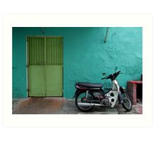 turquoise wall and scooter Art Print