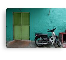 turquoise wall and scooter Canvas Print