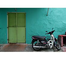 turquoise wall and scooter Photographic Print