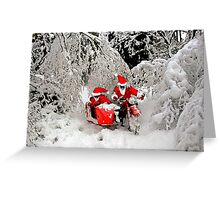 Santa Claus riding a motorcycle in a snow forest Greeting Card