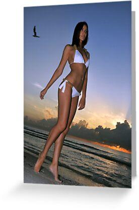 Beautiful brunette bikini model posing at sunrise in Miami beach, Florida  by Anton Oparin