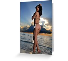 Beautiful brunette bikini model posing at cloudy Caribbean sunrise Greeting Card