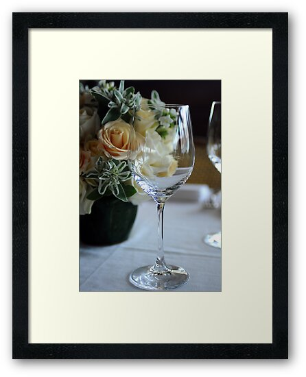 Empty wine glass on decorated restaurant table by Anton Oparin