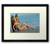 Pretty woman in blue bikini arching her back on a beach  Framed Print