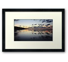 Clouds mirrored on wet beach Framed Print