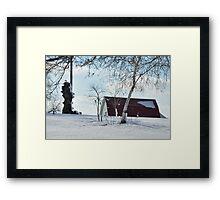 A snowy farm scene Framed Print