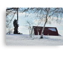 A snowy farm scene Canvas Print