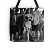 charging through the crowd Tote Bag