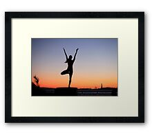 Tree pose silhouette in front of the Statue of Liberty, New York Framed Print