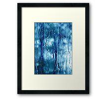 Heavy rain drops on blue window  Framed Print
