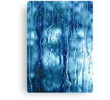 Heavy rain drops on blue window  Canvas Print