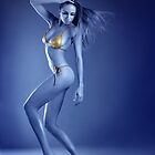 Vivid ultraviolet sexy blond model posing in gold metallic bikini. by Anton Oparin