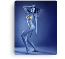 Vivid ultraviolet sexy blond model posing in gold metallic bikini. Canvas Print