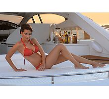 Brazilian model sitting pretty at the deck of 62 ft. motor boat. Photographic Print