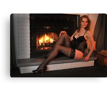Beautiful tall redhead in lingerie sitting in front of  fireplace  Canvas Print