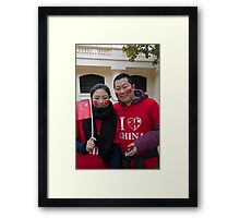 A chinese couple with painted faces and flags wait for President Xi Framed Print