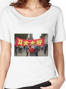ladies take selfies in front of the Chinese banners in the mall during the state visit Women's Relaxed Fit T-Shirt