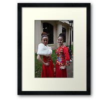 Chinese ladies in traditional dress in the mall Framed Print