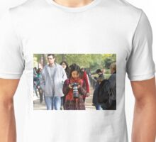 Chinese photographer checks her photos in the mall Unisex T-Shirt