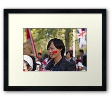 Chinese man with a flag sticker on his face in the Mall Framed Print
