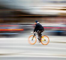 Cyclist in motion by portokalis