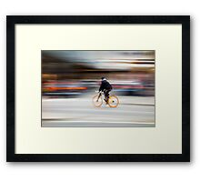 Cyclist in motion Framed Print