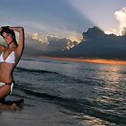 Beautiful brunette posing in a water at sunrise in Miami beach, Florida  by Anton Oparin