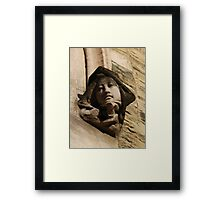 Face on the wall Framed Print